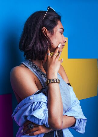 lifestyle people concept. young pretty smiling indian girl with long nails wearing lot of jewelry rings, asian summer happy cool close up Reklamní fotografie