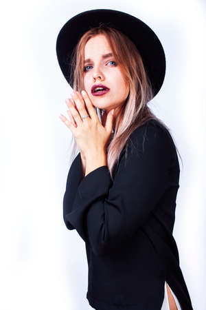 young pretty hipster girl in hat emotional posing, gesturing, fashion addict shopping people concept
