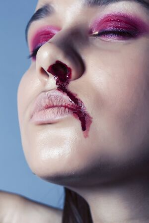 problem depressioned teenager with bleeding nose, real junky close up mainstream angry concept, lifestyle people