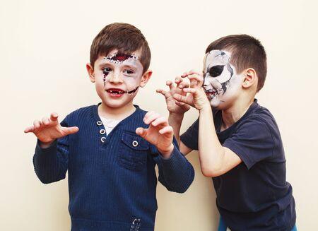 zombie apocalypse kids concept. Birthday party celebration facepaint on children dead bride, scar face, zombie skeleton together closeup makeup emotional posing. Standard-Bild - 143751444