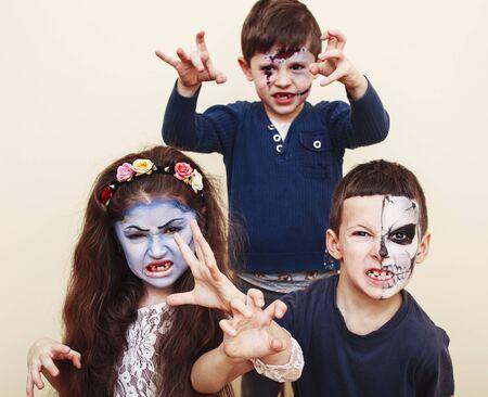 zombie apocalypse kids concept. Birthday party celebration facepaint on children dead bride, scar face, zombie skeleton together closeup makeup emotional posing. Standard-Bild - 143751447