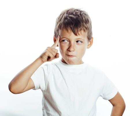 young pretty little boy wondering face gesturing, pointing isolated on white background 版權商用圖片
