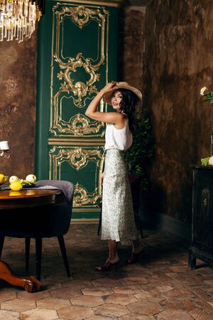 young pretty rich italian woman in golden luxury room interior, elegant styled hotel, people on vacation