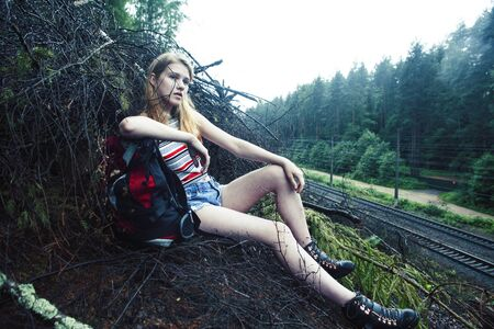young pretty tourist girl with backpack in forest, travel lifestyle people concept