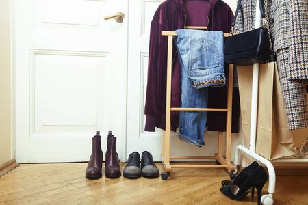 set of clothers and shoes in flat hanging on rail, modern girl casual wardrobe concept