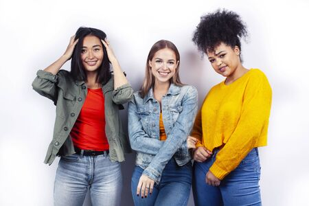diverse nation girls group, teenage friends company cheerful having fun, happy smiling, cute posing isolated on white background, lifestyle people concept Foto de archivo