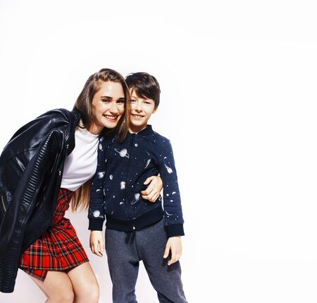 lifestyle and people concept, little cute boy with teenage girl posing together cheerful happy smiling isolated on white background