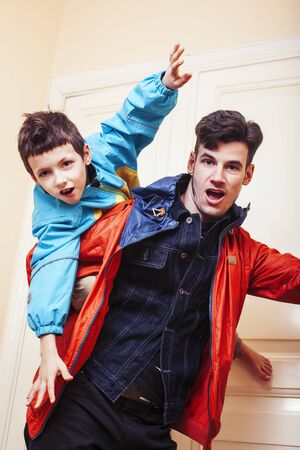 faher and son together having fun at home, lifestyle happy family, people at home