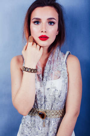 young pretty blond woman wearing lot of luxury rich jewelry and fashion style makeup, lifestyle beauty people concept