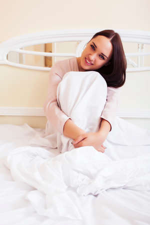 young pretty brunette woman laying in bed, luxury white interior vintage having breakfast cute