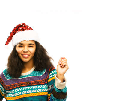 cute young real african hipster girl in santas red hat isolated on white background waiting for winter Christmass