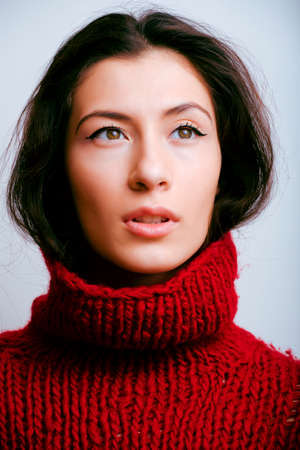 young pretty woman in sweater and scarf all over her face, lifestyle people winter concept
