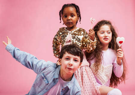 lifestyle people concept: diverse nation children playing together, boy and girl, caucasian and african american