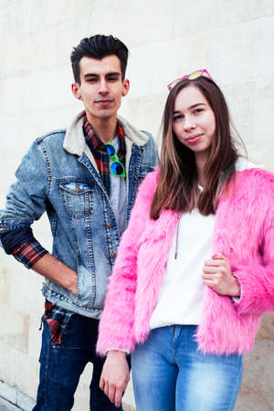 young pretty couple of student boy and girl together outside happy smiling, lifestyle people concept 스톡 콘텐츠