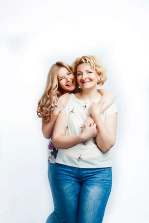 mother with teen daughter together posing happy smiling isolated on white background with copyspace, lifestyle people concept