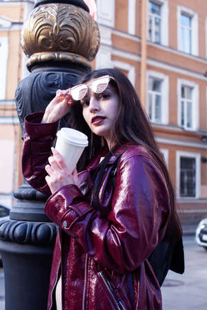 young pretty girl outside in city street with coffee happy smiling, lifestyle fashion peopple concept