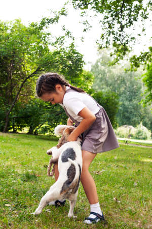 little cute girl outside playing with dog, lifestyle people concept