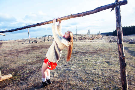 young pretty fashion style teenage girl posing cheerful at countryside background, lifestyle vacation people concept
