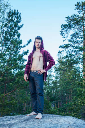 young attractive guy in woods alone practicing sport activity, lifestyle people concept Archivio Fotografico