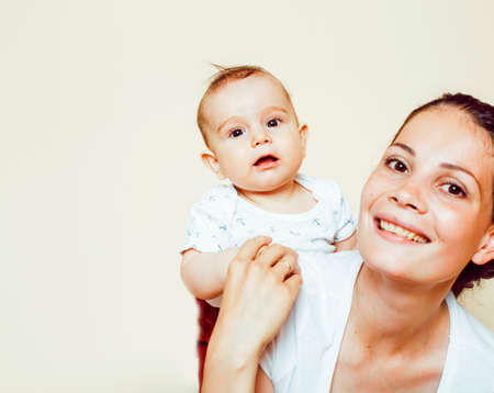 young brunette happy mother holding toddler baby son, breast-feeding concept, people lifestyle