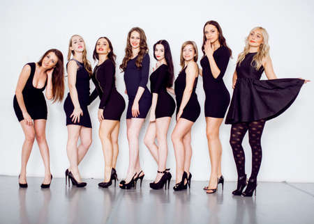 Many diverse women in line, wearing fancy little black dresses, party makeup, vice squad concept lifestyle Stok Fotoğraf