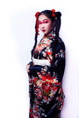 young pretty geisha in black kimono with sakura, asian ethno closeup on white background isolated Stok Fotoğraf