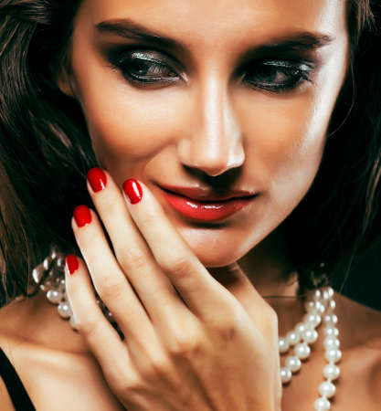 beauty rich woman with bright makeup wearing luxury jewellery on black background, fashion lady curly hairstyle Zdjęcie Seryjne
