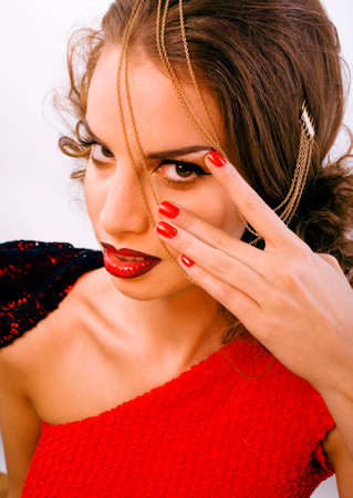 young pretty woman with fashion style makeup, chain like gussar role isolated on white background, red nails manicure