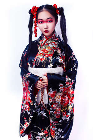 young pretty geisha in black kimono with sakura, asian ethno closeup on white background isolated Banco de Imagens