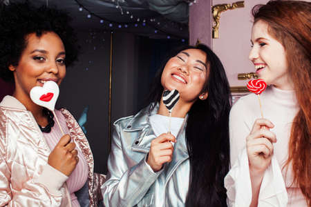 Lifestyle and people concept: young pretty diversity nations woman celebrating on birth day party together happy smiling, making selfie. African-american, asian and caucasian