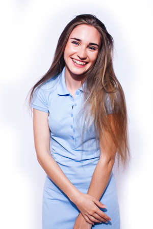 young pretty teenage hipster girl posing emotional happy smiling on white background, lifestyle people concept Stock fotó