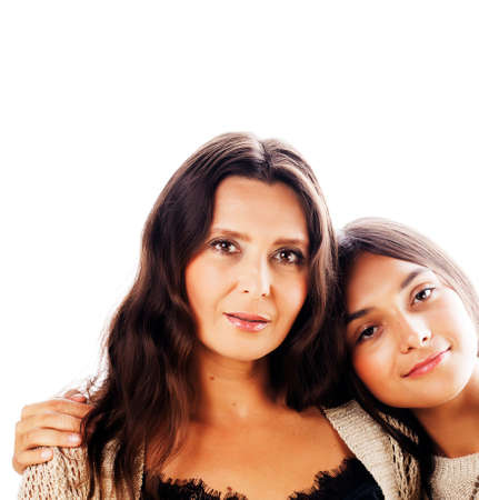 cute pretty teen daughter with mature mother hugging, fashion style brunette, lifestyle people concept Stock Photo