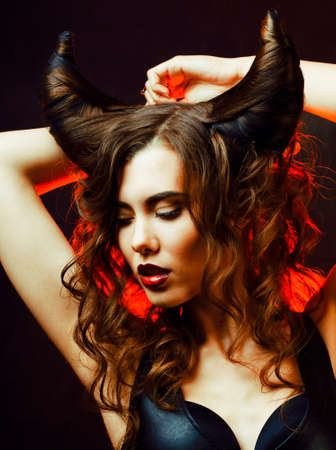 bright mysterious woman with horn hair, halloween celebration Banque d'images