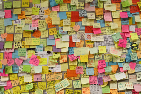 occupy wall street: Lennon Wall in hong kong - umbrella revolution  occupy central Editorial