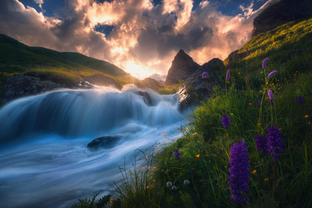 sunrise over fast mountain river