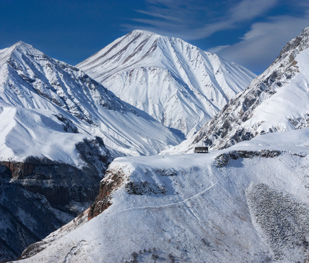 View of Caucasian Mountain in winter. Cross Pass in Georgia. Gudauri District. Stock Photo