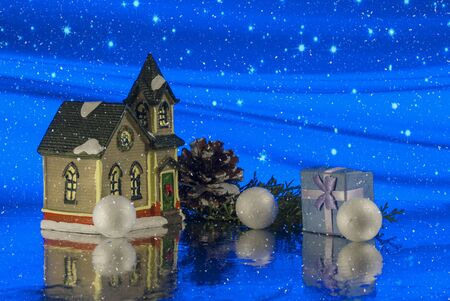 Miniature Toy House with gift or present box. Christmas Story. magical background. Close up