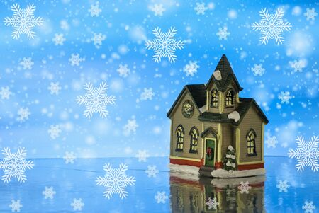Beautiful creative winter composition. Christmas Story. Small toy house. magical background. Close up