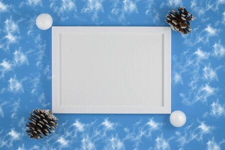 Christmas or New year holiday composition. picture frame and Christmas balls on fashion background. top view. Flat lay