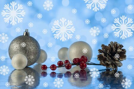 Beautiful Christmas composition with pine cone and decorative snowballs against holiday lights background Stock fotó