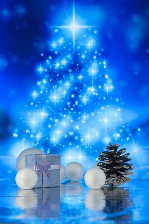 Beautiful Christmas gift or present box in snow and decoration against holiday lights background
