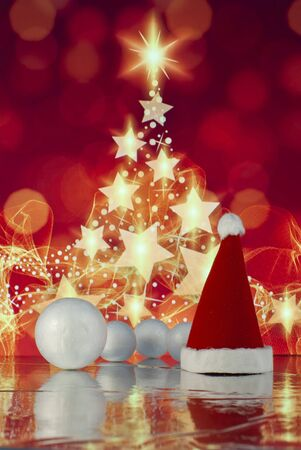 Christmas composition with Santa claus cap, gift or present box against holiday lights background Zdjęcie Seryjne