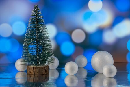 Beautiful Christmas composition with Christmas trees against holiday lights background