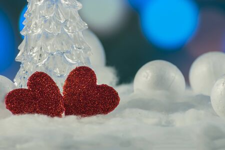 Two beautiful romantic vintage red hearts together on a winter background. Love and St. Valentines Day concept.