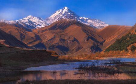 Landscape view of A beautiful scene of misty mountain Kazbek in winter Reklamní fotografie