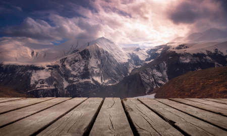View of Mountain in winter, with empty wooden table. Natural template landscape. Фото со стока