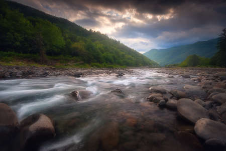 Beautiful summer landscape. Fast flowing mountain river. 版權商用圖片
