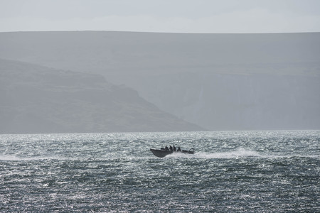 english channel: A motorboat sailing  on the English Channel Stock Photo