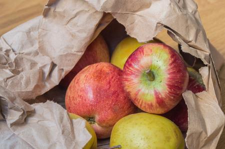 apple paper bag: Fresh apples in paper bag Stock Photo