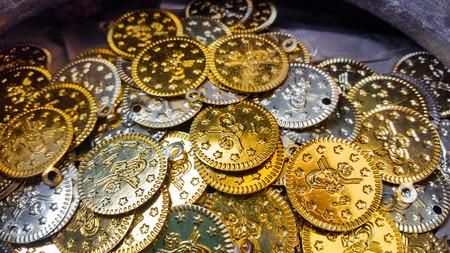 silver coins: Fake gold and silver coins closeup Stock Photo